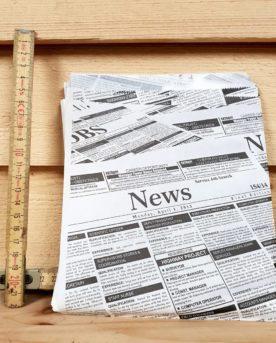 En hamburgerficka i design av en morgontidning. Lätt vaxat papper